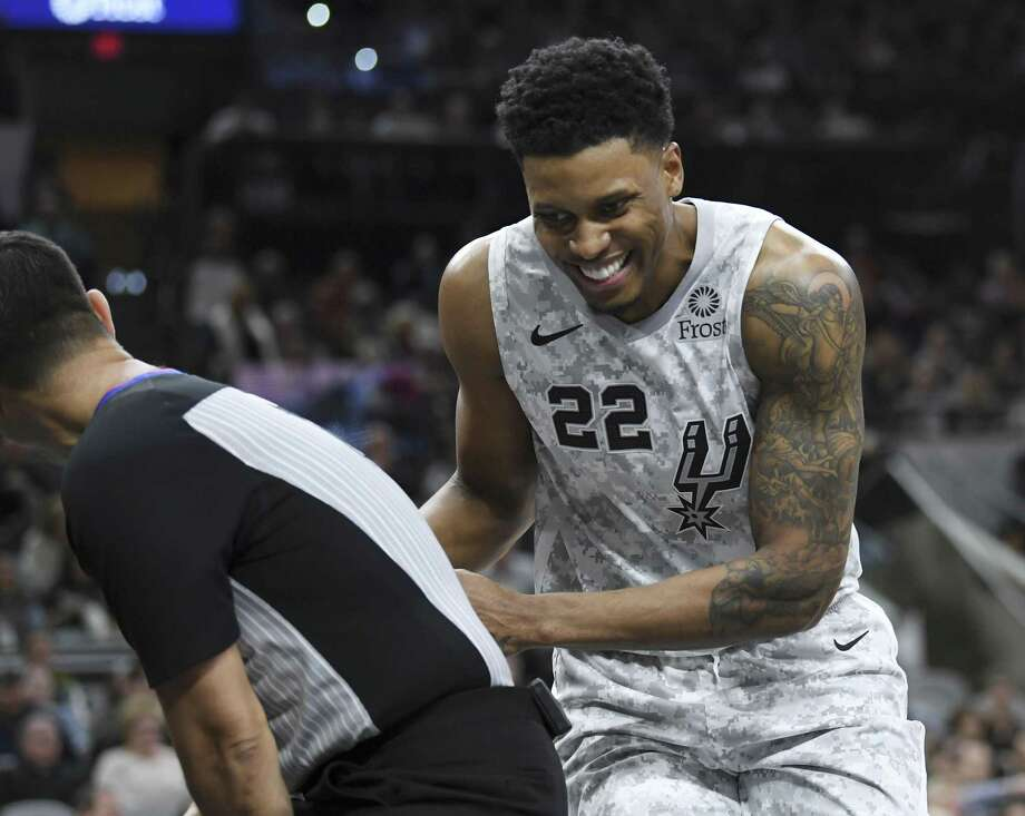 Rudy Gay of the San Antonio Spurs takes cover behind a referee as a bat flies by during NBA action in the AT&T Center on Saturday, Feb. 2, 2019. The flying mammals have taken up residence in the arena. Photo: Billy Calzada, Staff / Staff Photographer / San Antonio Express-News