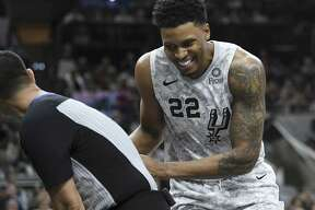 Rudy Gay of the San Antonio Spurs takes cover behind a referee as a bat flies by during NBA action in the AT&T Center on Saturday, Feb. 2, 2019. The flying mammals have taken up residence in the arena.