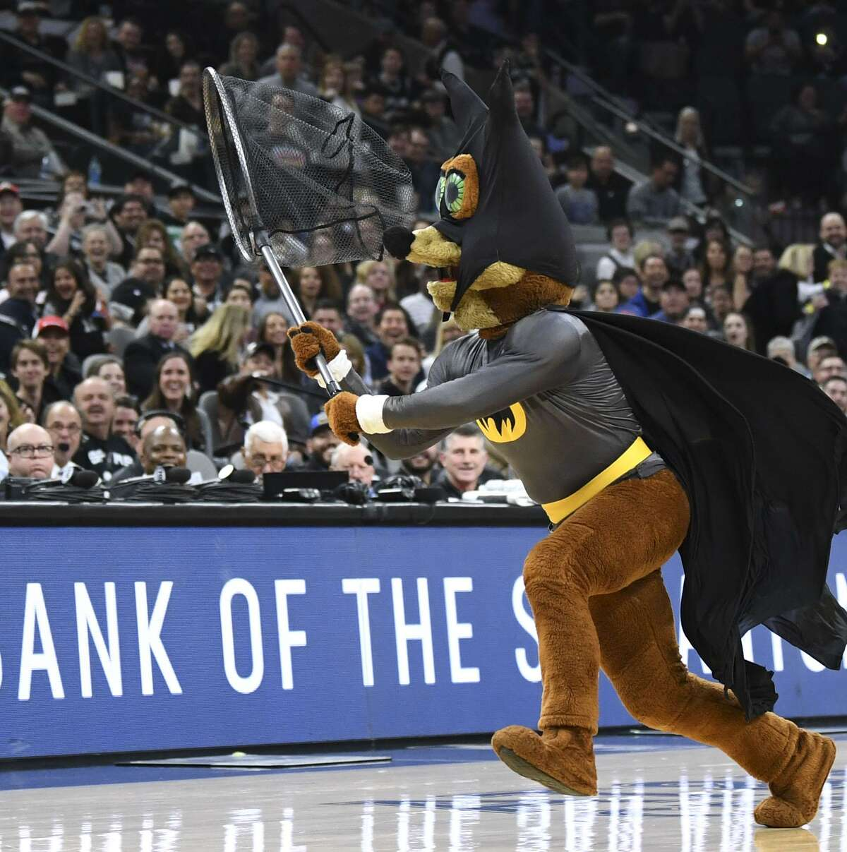 The Spurs Coyote catches a bat in a net during NBA action against the New Orleans Pelicans. in the AT&T Center on Saturday, Feb. 2, 2019. The flying mammals have been frequently spotted in the arena.