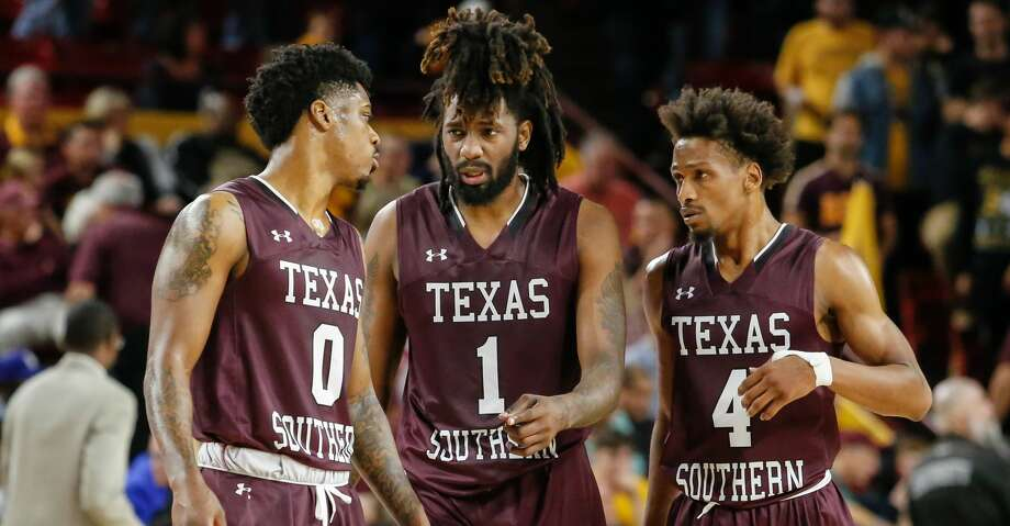 TEMPE, AZ - DECEMBER 01:  Texas Southern Tigers forward Devocio Butler (0), Texas Southern Tigers forward Jeremy Combs (1) and Texas Southern Tigers guard Derrick Bruce (4) discuss strategy during the college basketball game between the Texas Southern Tigers and the Arizona State Sun Devils on December 1, 2018 at Wells Fargo Arena in Tempe, Arizona. (Photo by Kevin Abele/Icon Sportswire via Getty Images) Photo: Icon Sportswire/Icon Sportswire Via Getty Images
