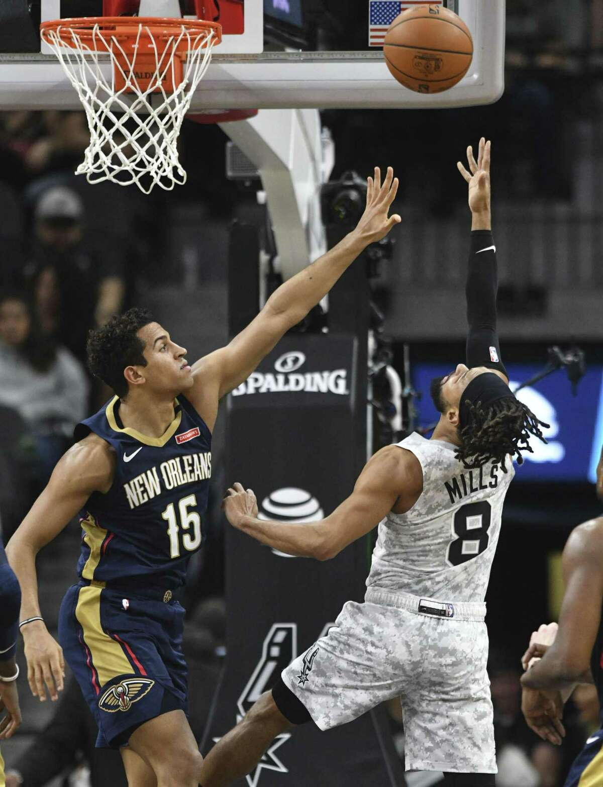 Patty Mills (8) of the San Antonio Spurs shoots and scores over Frank Jackson of the New Orleans Pelicans during NBA action in the AT&T Center on Saturday, Feb. 2, 2019.