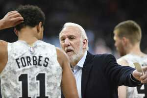 San Antonio Spurs coach Gregg Popovich speaks with guard Bryn Forbes about his defense during NBA action against New Orleans in the AT&T Center on Saturday, Feb. 2, 2019.