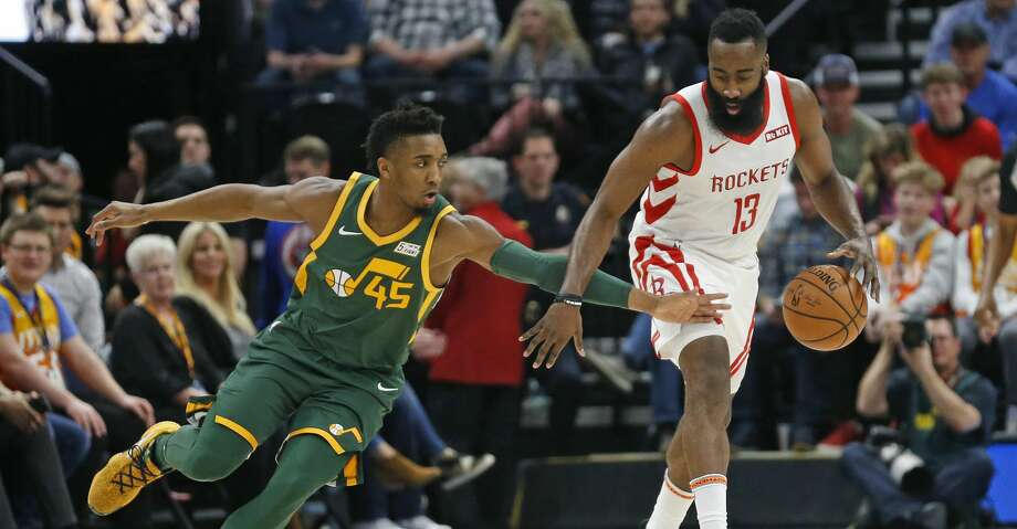 521382d610db Utah Jazz guard Donovan Mitchell (45) reaches for the ball as Houston  Rockets guard