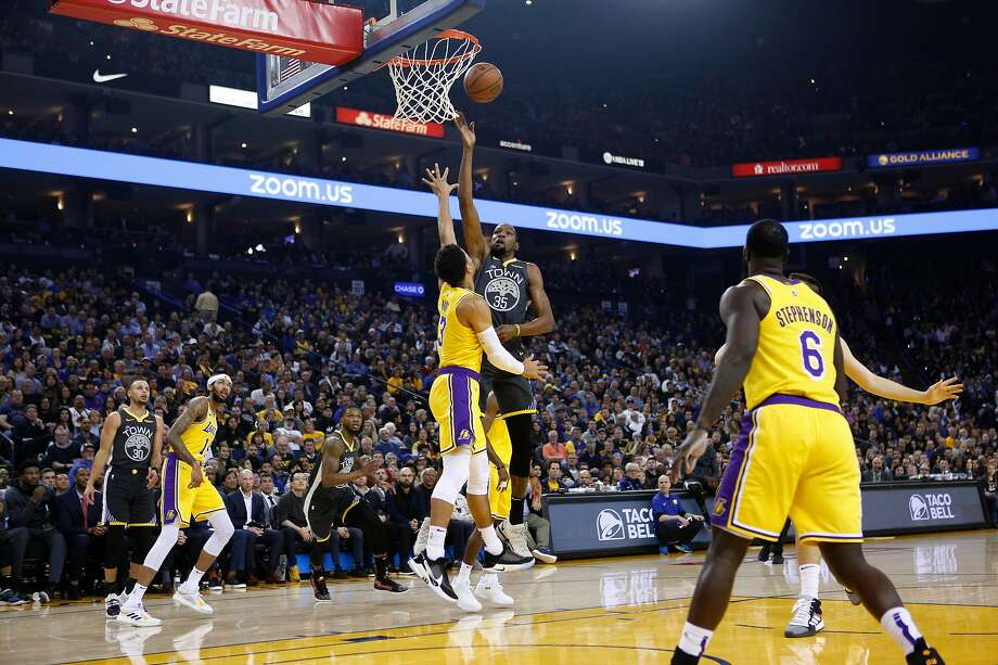 Warriors forward Kevin Durant gets off a shot over Lakers guard Josh Hart (3) in the first half of an NBA game at Oracle Arena on Saturday, Feb. 2, 2019, in Oakland, Calif. The Warriors won 115-101. Photo: Santiago Mejia / The Chronicle