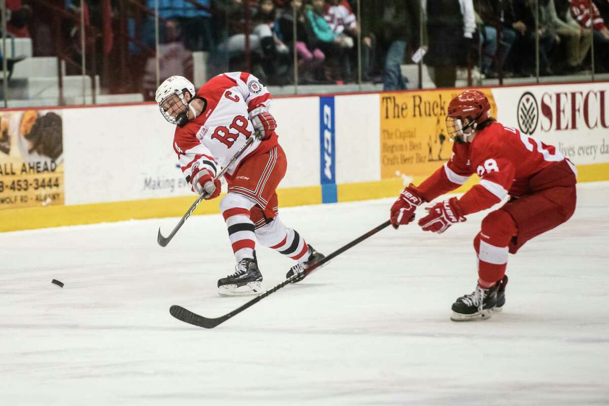 RPI's Tommy Grant fires the puck past Cornell's Brenden Locke as the two teams faced off Saturday, February 2nd, 2019 at RPI's Houston Field House in Troy, NY. Photo by Eric Jenks, for the Times Union