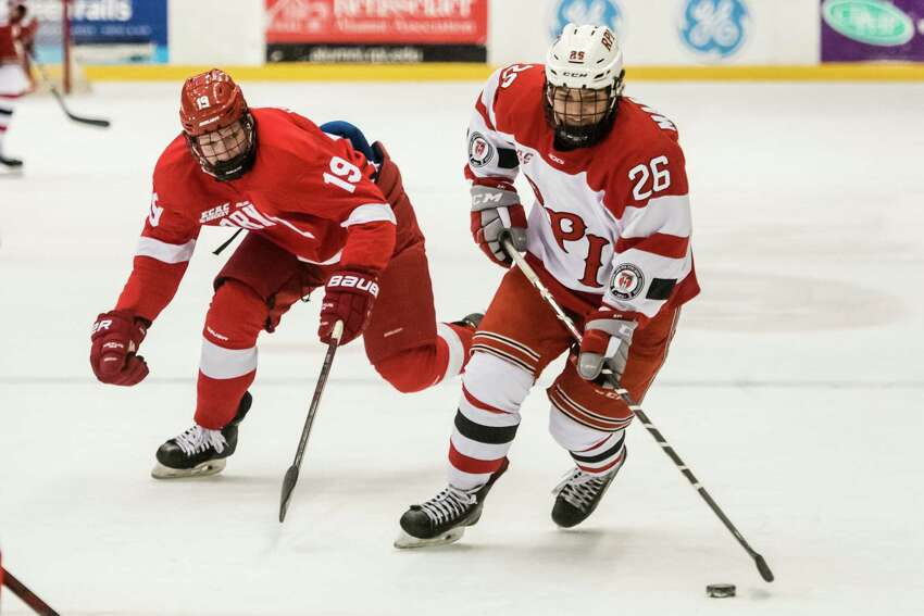 RPI's Jake Marrello handles the puck while Cornell's Michael Regush moves in from behind Saturday, February 2nd, 2019 at RPI's Houston Field House in Troy, NY. Photo by Eric Jenks, for the Times Union