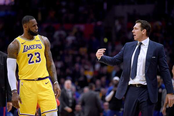 0cb62196afe 1of4LeBron James  23 of the Los Angeles Lakers and Luke Walton talk during  a timeout during a 123-120 win over the LA Clippers at Staples Center on  January ...