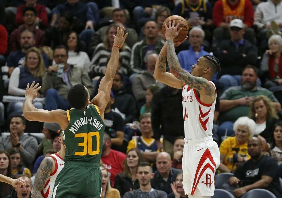 Houston Rockets guard Gerald Green (14) shoots as Utah Jazz guard Naz Mitrou-Long (30) defends during the second half of an NBA basketball game Saturday, Feb. 2, 2019, in Salt Lake City. (AP Photo/Rick Bowmer) Photo: Rick Bowmer/Associated Press