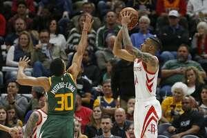 Houston Rockets guard Gerald Green (14) shoots as Utah Jazz guard Naz Mitrou-Long (30) defends during the second half of an NBA basketball game Saturday, Feb. 2, 2019, in Salt Lake City. (AP Photo/Rick Bowmer)
