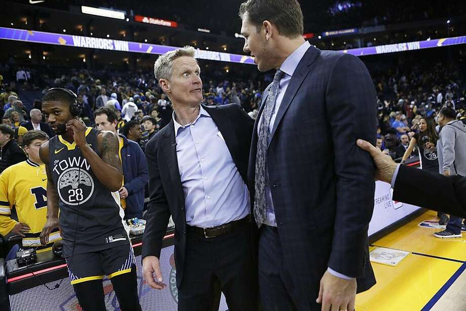 FILE - Golden State Warriors head coach Steve Kerr with Los Angeles Lakers head coach Luke Walton following the NBA game at Oracle Arena in Oakland, in this photo February 2, 2019 in Oakland. The warriors won 115-101. Walton, sacked from the Los Angeles Lakers after being their coach for three seasons, was the assistant coach of Warriors head coach Kerr before coaching the Lakers. Kerr spoke of his shooting after practicing the Warriors, saying that Walton is