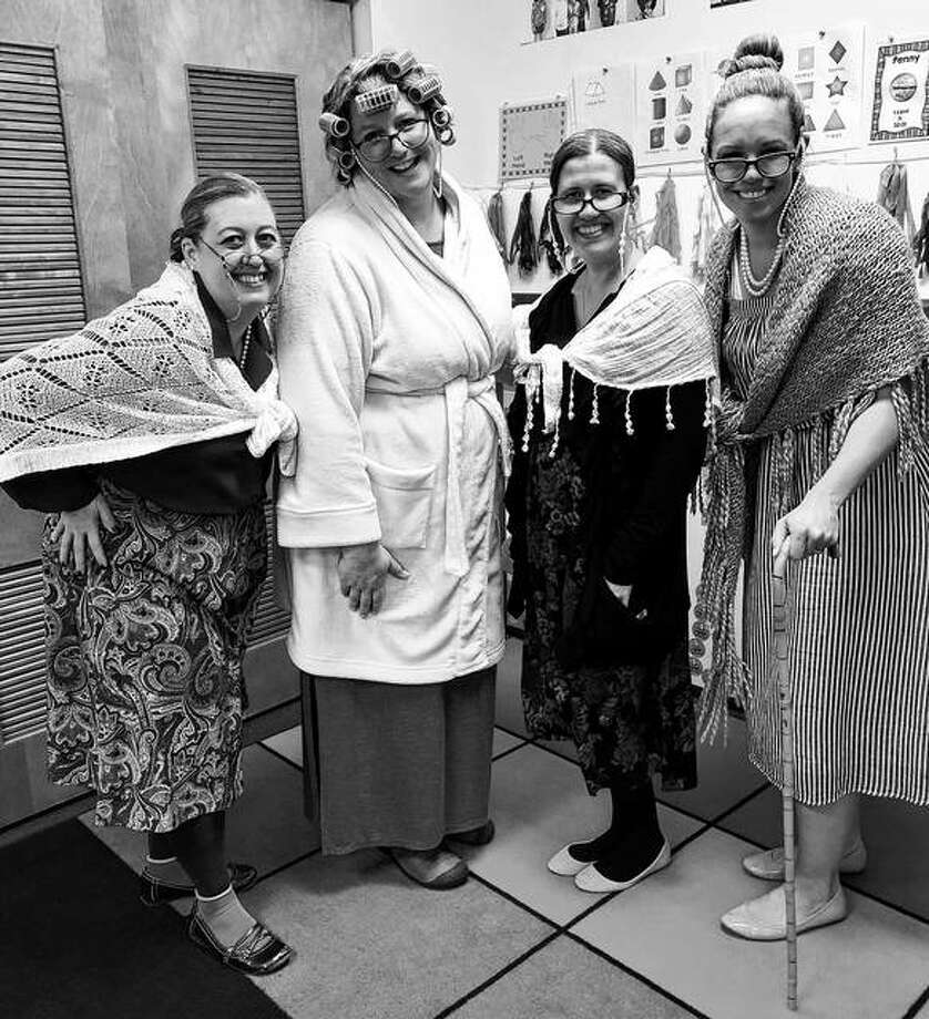Illinois School for the Deaf pre-K, kindergarten and first-grade teachers don costumes Jan. 25 to celebrate their students' 100th day of school for the year. Those participating included Misty Swift (from left), Allison Guidish, Sarah Dobson and Natalie Garver. Photo: Photo Provided
