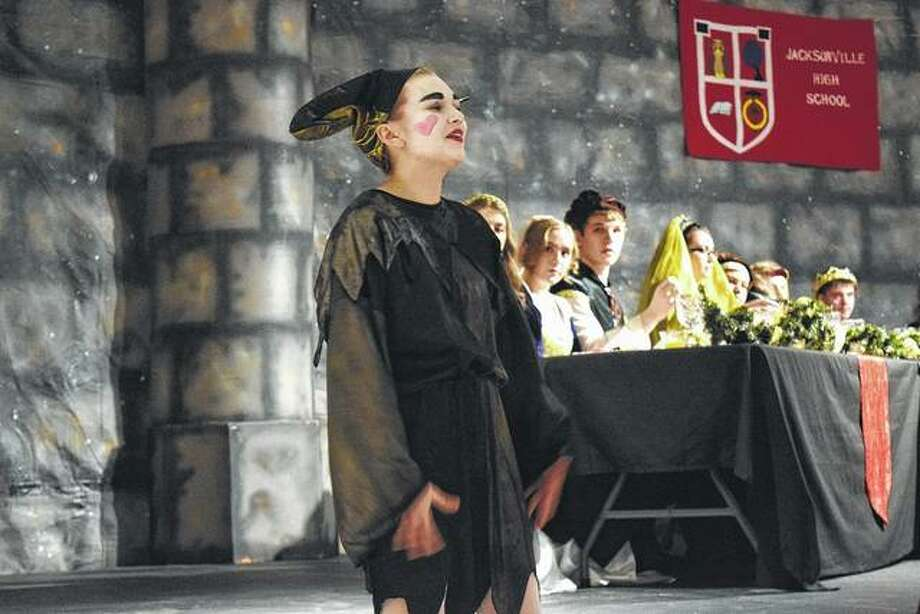 """The jester, played by Grace Smith, entertained the guests at Saturday evening's madrigal dinner at Jacksonville High School. The performance was an adaptation of """"The Wife of Bath"""" from Geoffrey Chaucer's """"The Canterbury Tales."""" The Queen and her court sent a knight on a quest and sang while guests were served dinner. Photo: Rosalind Essig   Journal-Courier"""
