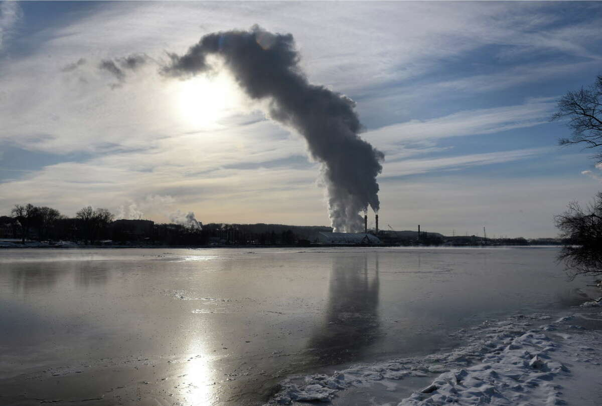 Steam and emissions rise from the Rensselaer Cogeneration power plant on Friday, Feb. 1, 2019, viewed from Albany, N.Y. Keep clicking for photos of what American looked like before the EPA.