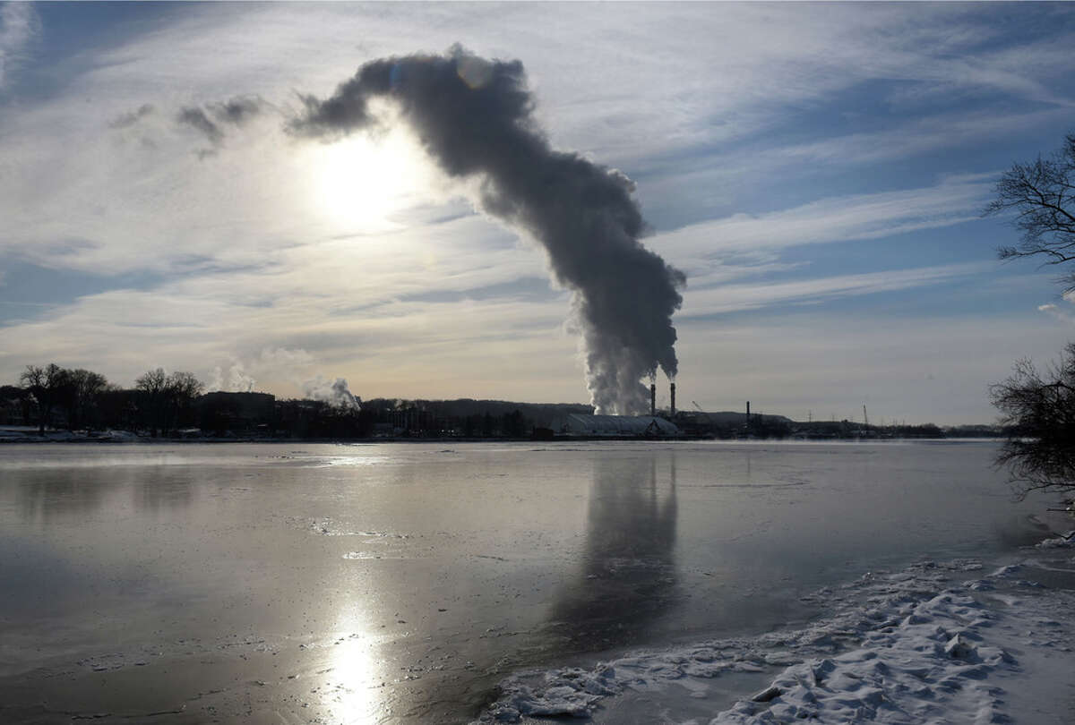 Steam and emissions rise from the Rensselaer Cogeneration power plant on Friday, Feb. 1, 2019, viewed from Albany, N.Y. (Will Waldron/Times Union)