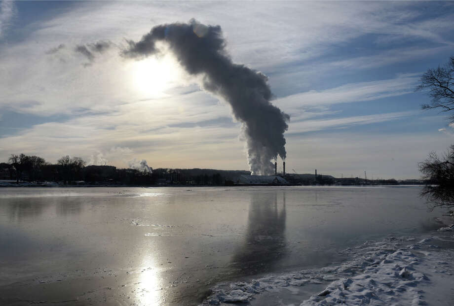 Steam and emissions rise from the Rensselaer Cogeneration power plant on Friday, Feb. 1, 2019, viewed from Albany, N.Y. (Will Waldron/Times Union) Photo: Will Waldron, Albany Times Union / 40046082A