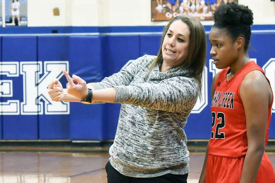 Langham Creek head basketball coach Annette Steward and forward Saija Cleveland discuss the game plan during a CFISD matchup. Photo: CFISD