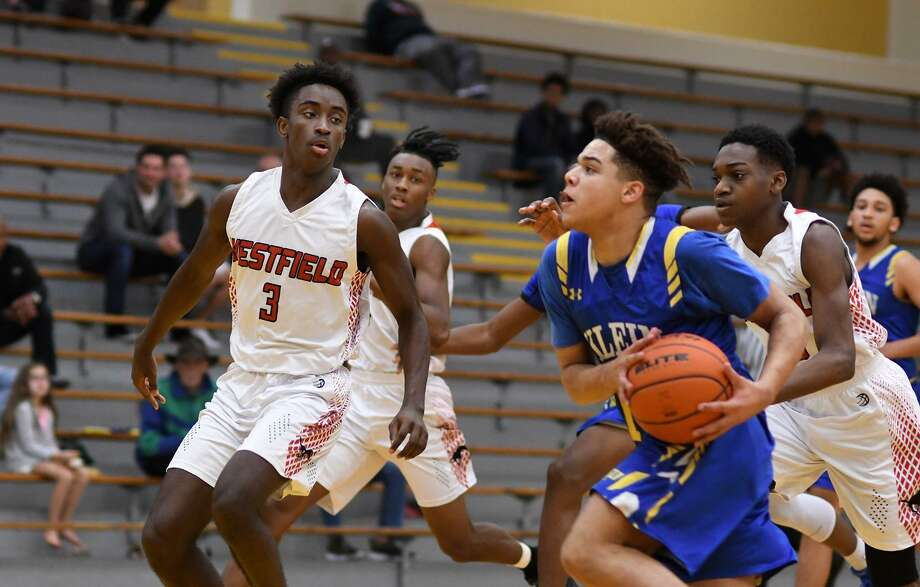 Klein sophomore Aaron Hutchinson (12) works the ball upcourt against Westfield senior Caleb Edwards (3) during their matchup at the 54th Annual Conroe Christmas Classic at Conroe High School on Dec. 28, 2018. Hutchinson was named the 2018-19 District 15-6A Newcomer of the Year, along with two others. Photo: Jerry Baker, Houston Chronicle / Contributor / Houston Chronicle