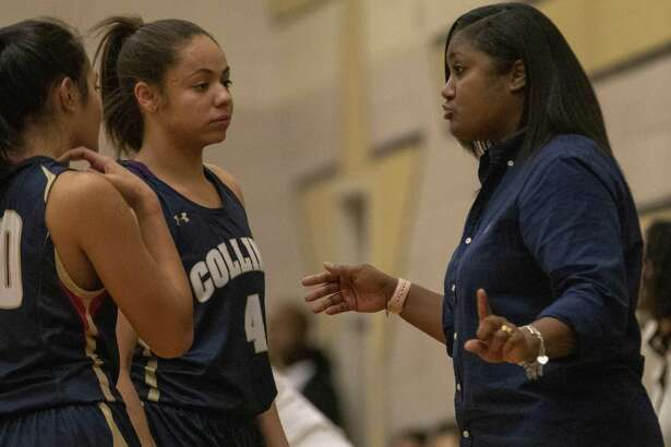 Klein Collins head coach Tatiana Lee speaks with players during a District 15-6A high school basketball game Tuesday, Jan.29, 2019 in Conroe.