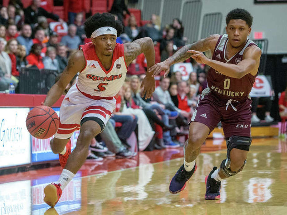 SIUE's Tyresse Williford (left) drives past Eastern Kentucky's Dujuanta Weaver during the Cougars' double-overtime victory Saturday night at Vadalabene Center in Edwardsville. Photo: Scott Kane / SIUE Athletics