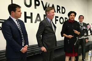 The Connecticut economic development team under Gov. Ned Lamont, introduced in Hartford Friday, Feb. 1, 2019. From left David Lehman, 41, of Greenwich, leaving his job as a top manager at Goldman Sachs; Lamont; Indra Nooyi, 61, of Greenwich, recently retired chairman and CEO of PepsiCo, at the podium; and Jim Smith, 70, of Middlebury. Nooyi and Smith will be co-chairs of the Connecticut Economic /Resource Center.