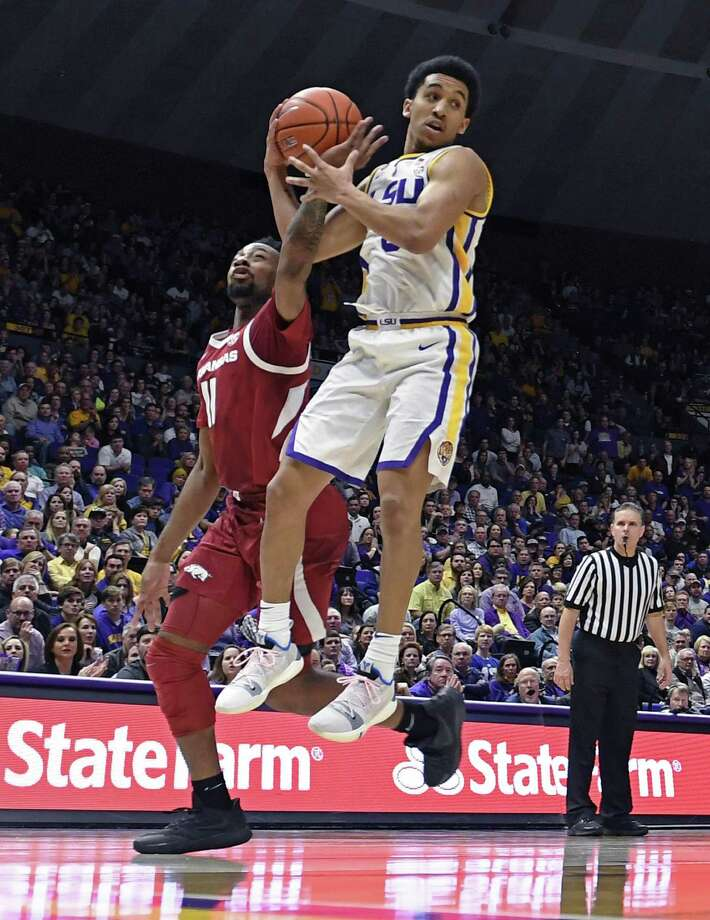 New Haven native Tremont Waters, right, poured in 36 points for LSU in a win over Texas A&M on Wednesday. Photo: Bill Feig / Associated Press / FR44286 AP