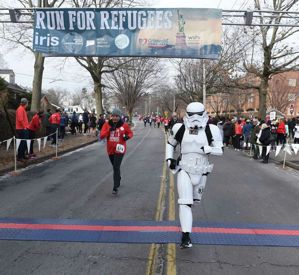 Thousands run in the 12th Annual IRIS Run for Refugees 5K in New Haven on February 3, 2019.