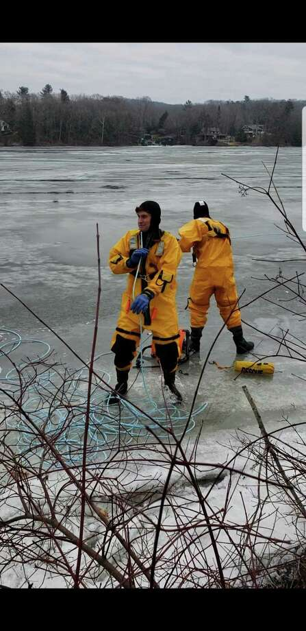 Firefighters Brock Butkovsky (left) and Chris Moquin (right) help rescue a deer that became stranded on the ice on Lake Zoar on Feb. 3, 2019. Photo: Tom Woerner / Stevenson Fire Department