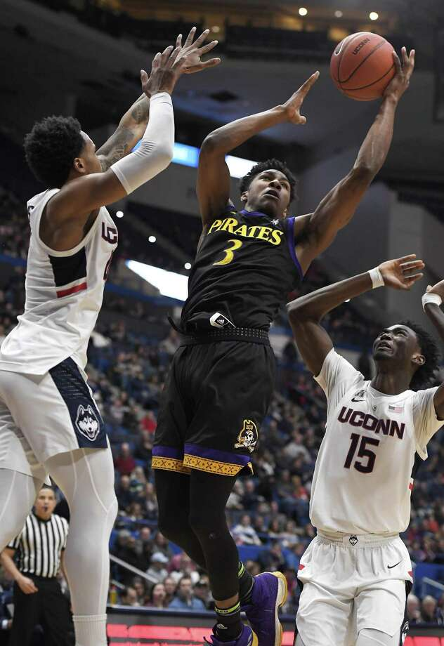 East Carolina's Seth LeDay (3) makes a basket between UConn's Jalen Adams (4) and Sidney Wilson (15) during the first half Sunday in Hartford. Photo: Jessica Hill / Associated Press / Copyright 2019 The Associated Press. All rights reserved