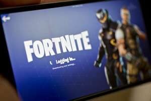 Fortnite's Battle Royale video game is displayed on an Apple iPhone; a major bug in Fortnite gave hackers access to millions of player accounts. MUST CREDIT: Bloomberg photo by Andrew Harrer.