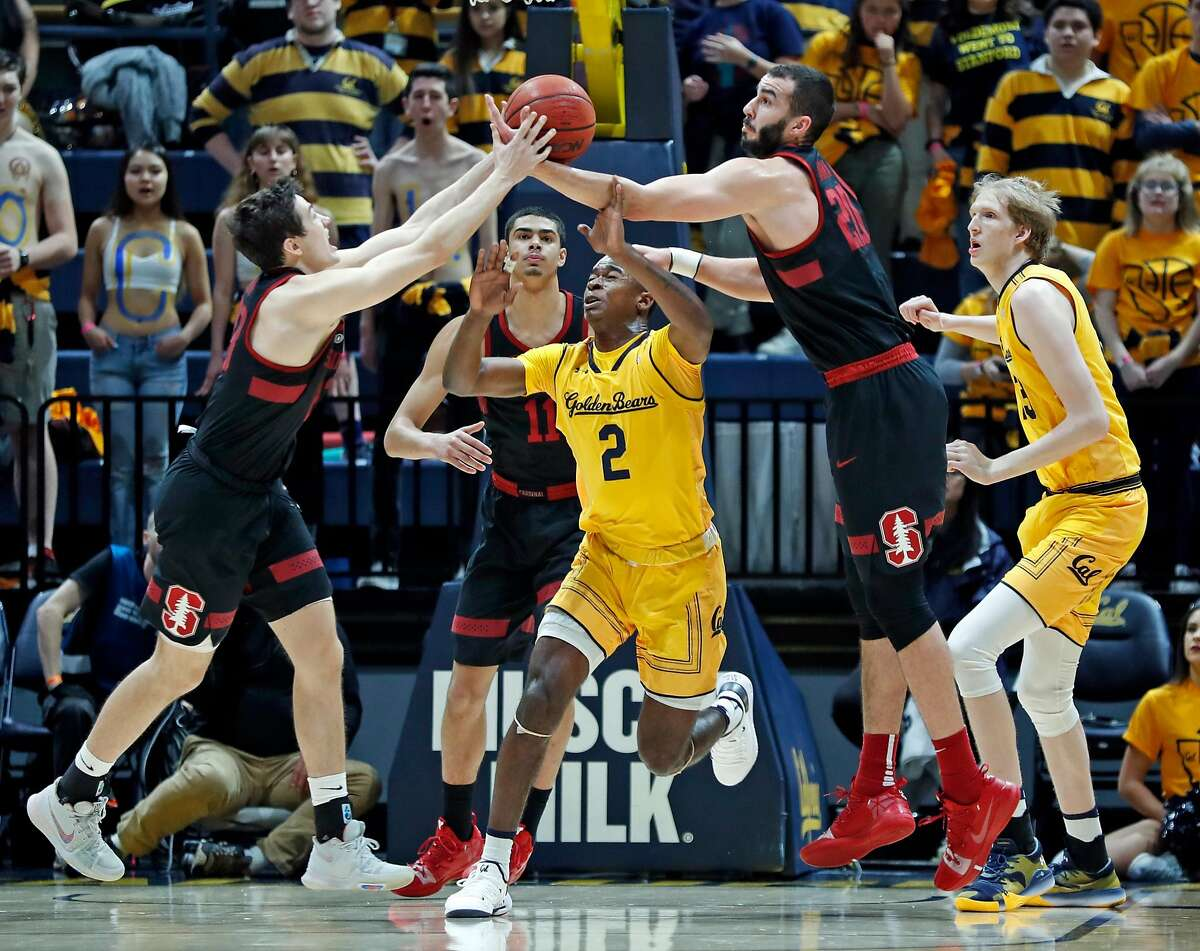 Stanford's Cormac Ryan and Josh Sharma reach for a loose ball against California's Juhan Harris-Dyson in 1st half during Pac 12 Men's basketball game at Haas Pavilion in Berkeley, Calif., on Thursday, February 3, 2019.