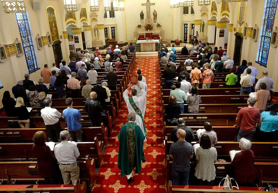 Congregants attend Saturday evening mass at St. Anne's Catholic Church in Beaumont. Area churches, clergy and parishioners continue to grapple with last week's naming of priests within the diocese who were accused of sexual misconduct.