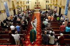 Congregants attend Saturday evening mass at St. Anne's Catholic Church in Beaumont. Area churches, clergy and parishioners continue to grapple with last week's naming of priests within the diocese who were accused of sexual misconduct. Photo taken Saturday, February 2, 2019 Photo by Kim Brent/The Enterprise