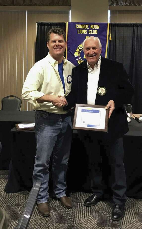 Conroe Noon Lions Club current President Bobby Brennan congratulates Past President Bobby Cantrell on his 45 years anniversary in the club at last week's meeting.