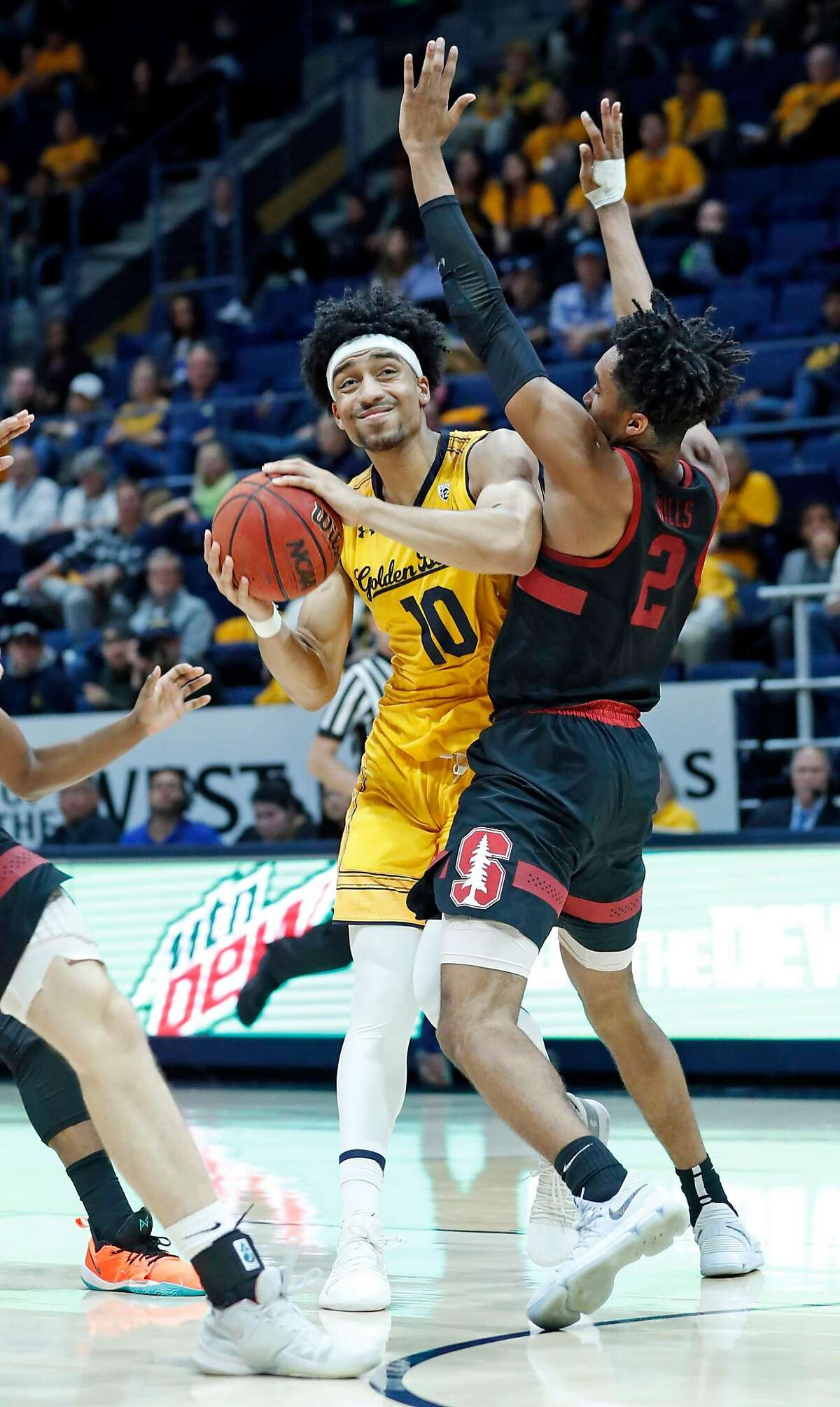 California's Justice Sueing drives into Stanford's Bryce Wills during Stanford's 84-81 win in Pac 12 Men's basketball game at Haas Pavilion in Berkeley, Calif., on Thursday, February 3, 2019.