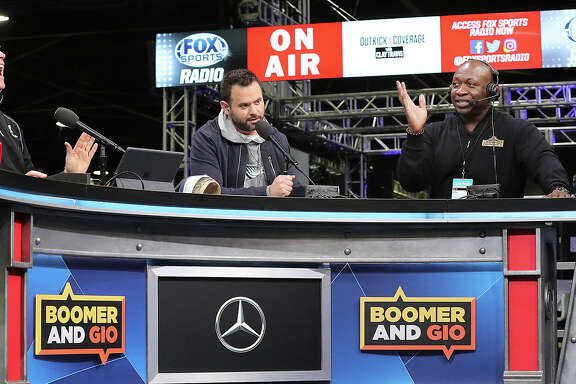 From left, former NFL quarterback Boomer Esiason breaks into laughter while he and Gregg Giannotti interview former defensive tackle John Randle for the CBS Sports Network on radio row at the Georgia World Congress Center on Thursday, Jan. 31, 2019, in Atlanta. (Curtis Compton/Atlanta Journal-Constitution/TNS)