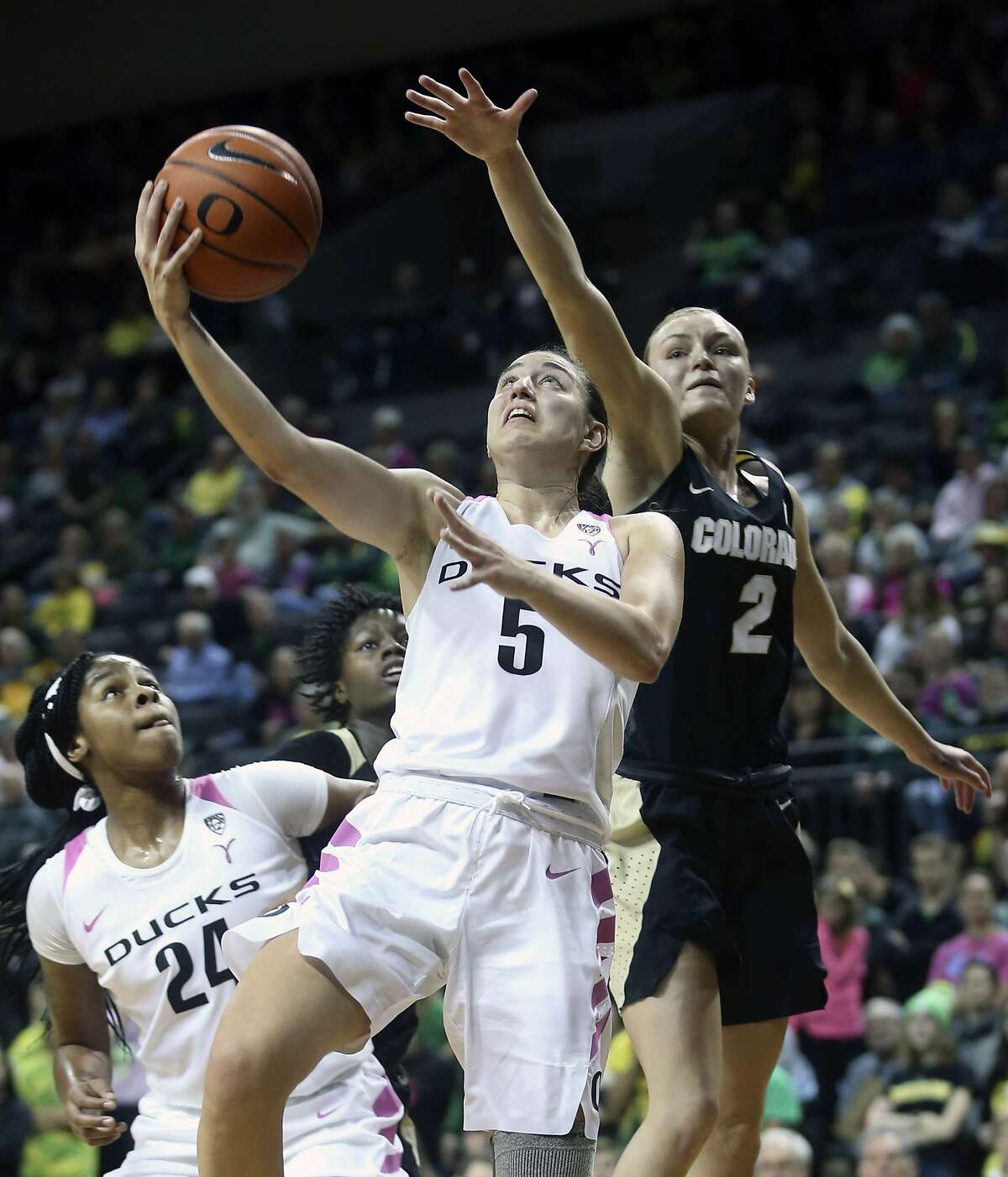 Oregon's Ruthy Hebard, left, sets a screen on Colorado's Mya Hollingshed, second from left, as Oregon's Maite Cazorla (5) goes up to shoot ahead of Colorado's Alexis Robinson (2) during the second quarter of an NCAA college basketball game Sunday, Feb. 3, 2019, in Eugene, Ore. (AP Photo/Chris Pietsch)