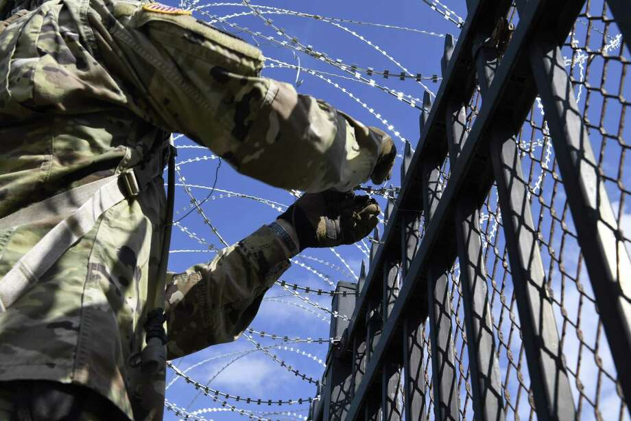 "(FILES) In this file image obtained from the US Air Force, US soldiers install concertina wire at the Anzalduas International Bridge in McAllen Texas, on November 5, 2018. - Thousands more troops will head to the US-Mexico border, Acting Defense Secretary Patrick Shanahan said January 29, 2019, as part of a controversial mission to enhance security along the frontier. Currently, about 2,350 active-duty troops are working along the border, where they are helping border patrol agents by providing logistical support and installing concertina-wire fencing. (Photo by Daniel A. Hernandez / US AIR FORCE / AFP) / RESTRICTED TO EDITORIAL USE - MANDATORY CREDIT ""AFP PHOTO / US Air Force / Airman First Class Daniel A. Hernandez"" - NO MARKETING NO ADVERTISING CAMPAIGNS - DISTRIBUTED AS A SERVICE TO CLIENTSDANIEL A. HERNANDEZ/AFP/Getty Images Photo: DANIEL A. HERNANDEZ, Handout / AFP/Getty Images / Public Domain"