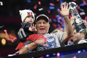 Patriots coach Bill Belichick celebrates with his granddaughter Blakely after winning Super Bowl LIII on Sunday.