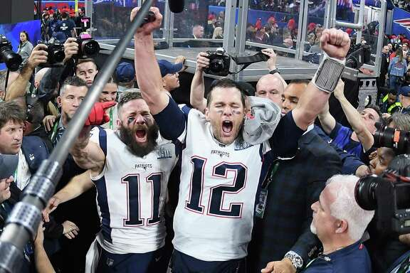 Patriots receiver Julian Edelman (11) and quarterback Tom Brady celebrate their Super Bowl LIII victory. Edelman was named the game's MVP after catching 10 passes (including eight for first downs) for 141 yards.