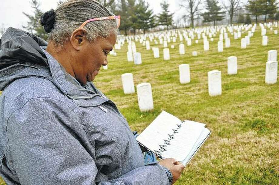 Corene McDaniel of Carbondale checks her research on black Civil War soldiers buried at Mound City National Cemetery. Photo: Gabriel Neely-Streit | The Southern