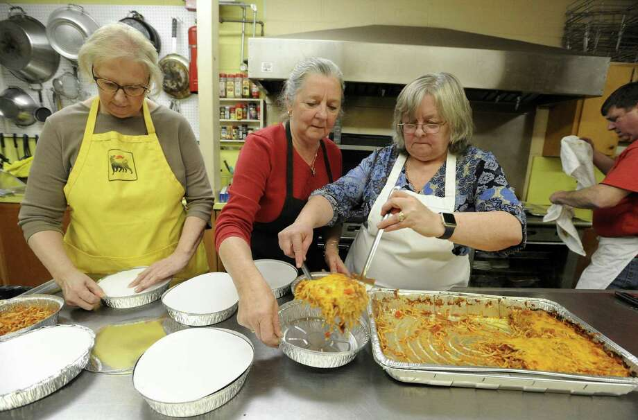 From left, church members Priscilla Altmann, Janice Holko Domiziano and Judy Holko-Piro serving up a Spaghetti Creole Supper at St. Paul Lutheran Church on Saturday, Feb. 2, 2019 in Greenwich, Connecticut. The original recipe, which consisted of a tomato sauce, onions, celery, red and green bell peppers and ground beef, mixed with #8 spaghetti topped with shredded cheese and baked in the oven, was founded by church mothers who worked in the Greenwich Public Schools back in the 1960s. Over 180 generous portions of spaghetti creole, along with salad, bread, dessert, and coffee or drink were served to guests attending the community event which served as a fund raiser for the churches Christian Education Programs. New to this years annual event, 18 half-tray orders of Spaghetti Creole were sold, to be heated up in ovens around the community for guests to enjoy during Super Bowl Sunday. Photo: Matthew Brown / Hearst Connecticut Media / Stamford Advocate