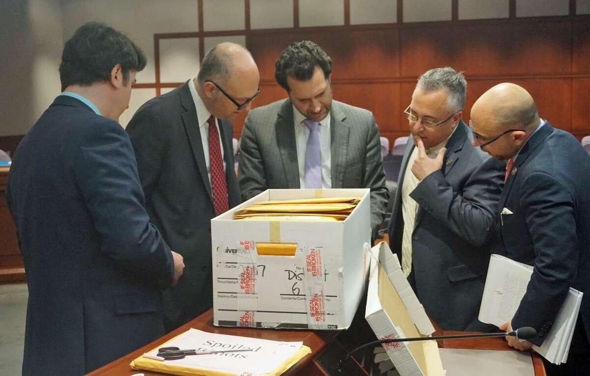 The Committee on Contested Elections looked at absentee ballots from Stratford in a meeting at the Legislative Office Building in Hartford, Conn. on Friday February 1, 2019. (L to R) Clerk Adam Skowera, Rep. Gregory Haddad, D-Storrs, Rep. Michael D'Agostino, D-Hamden, Rep. Vincent Candelora, R-North Branford and Rep. Jason Perillo, R-Shelton, examine a ballot together.