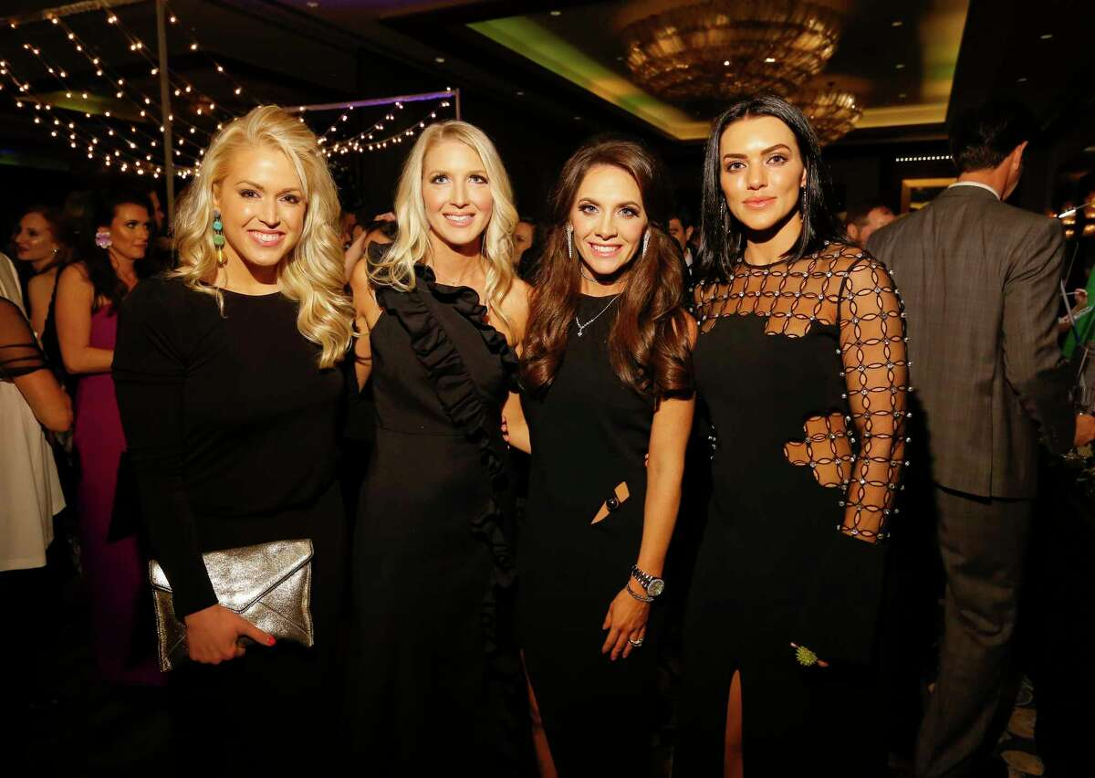 Ericka Graham, from left, Laura Hatfield, Joanna Marks and Megan Cushing pose for a photograph at the Park Lovers' Ball: La Jete du Jardin, The Garden Party at the Hilton Americas-Houston on Saturday, Feb. 2, 2019, in Houston.