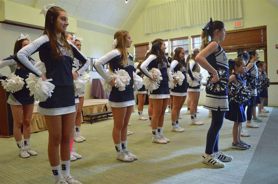 Grace Futterman, 18, of Westport, at left, and other Staples High School cheerleaders perform at the Center for Senior Activities' annual Super Bowl party, Sunday, Feb. 3, 2019, in Westport, Conn. Photo: Jarret Liotta / For Hearst Connecticut Media / Westport News Freelance