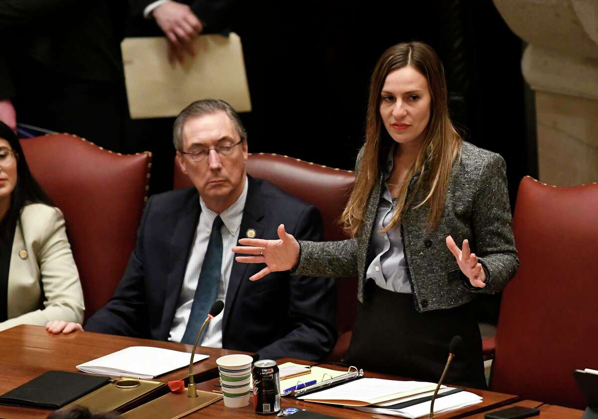 New York Sen. Alessandra Biaggi, D-Bronx ,right, explains their vote in the affirmative on the Child Victims Act in the Assembly Chamber at the state Capitol on Monday, Jan. 28, 2019, in Albany, N.Y.