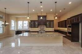 CYPRESS: 18206 Sandy Beach Court List price: $785,000 Square feet: 5,237