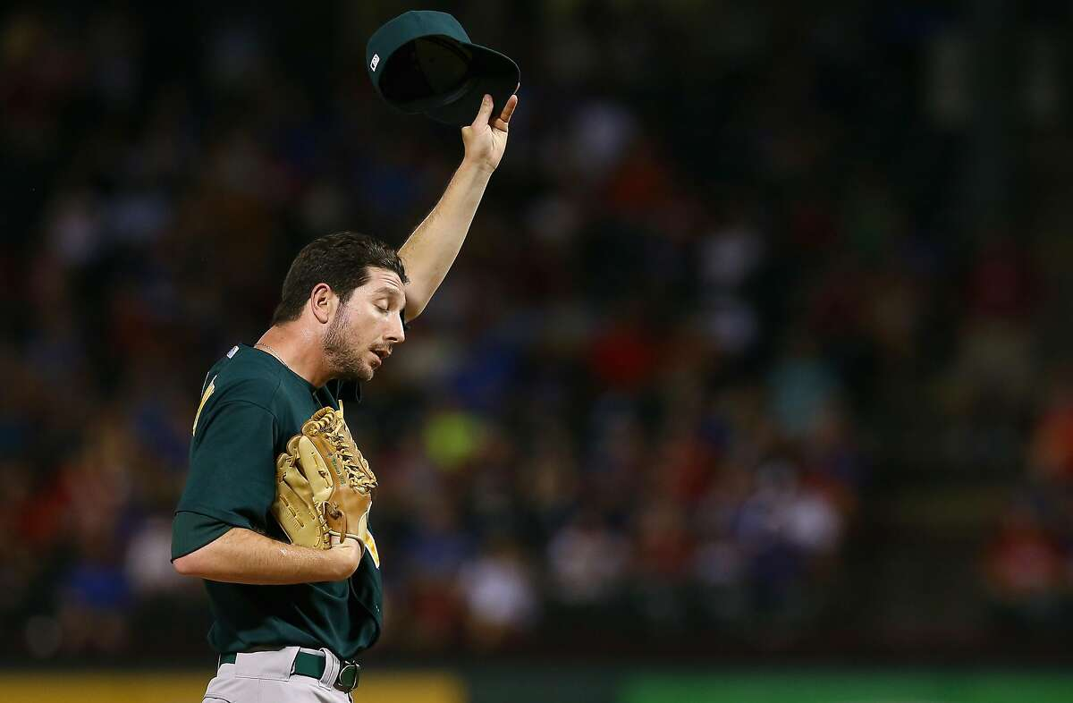 Jerry Blevins of the Oakland Athletics reacts after giving up a RBI double hit by Nelson Cruz of the Texas Rangers in the bottom of the seventh inning on June 17, 2013 in Arlington, Texas.