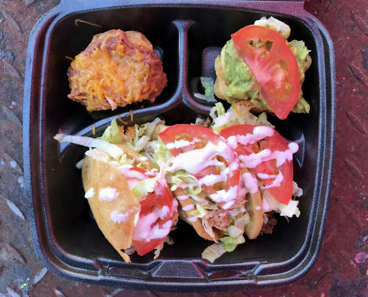 A bean cup, a guacamole cup, two puffy tacos and a chicken gordita from Lala's Gorditas