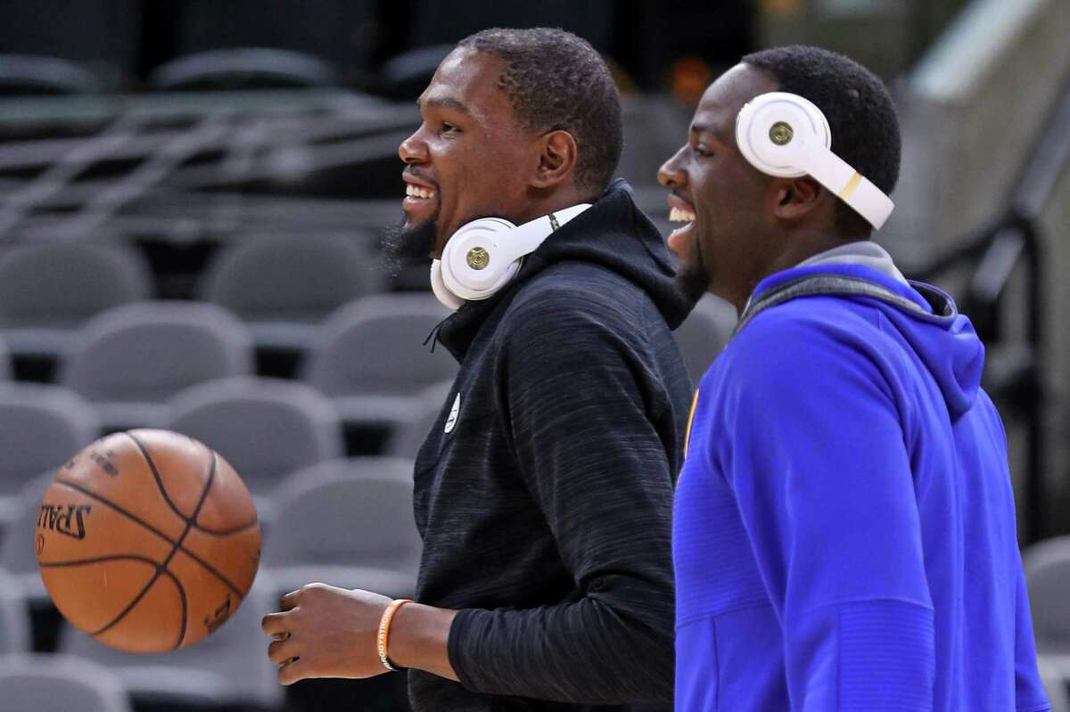 Golden State Warriors' Kevin Durant and Draymond Green after practice during NBA Western Conference Finals at AT&T Center in San Antonio, Texas, on Sunday, May 21, 2017.