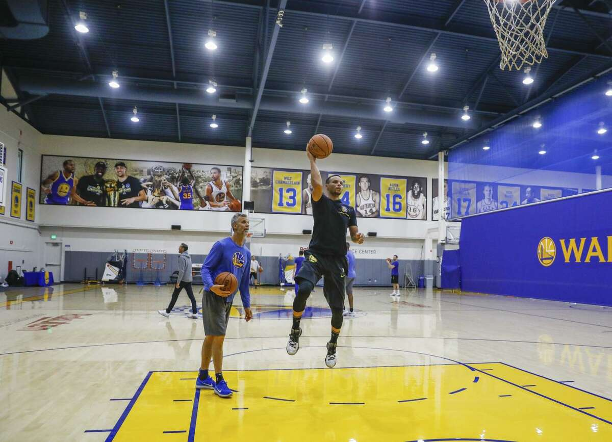 Stephen Curry warms up during a Warriors practice. Music selections are often associated with where the team is going to play, such as tunes by Kendrick Lamar and Dr. Dre when in L.A.